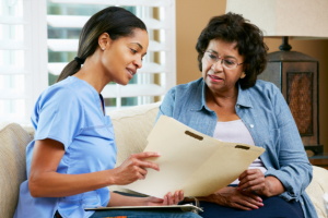elderly woman and caregiver having a discussion